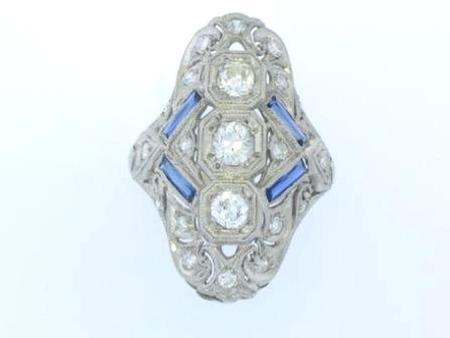 Platinum Estate ring with approximately 21 Diamonds            E. Filip