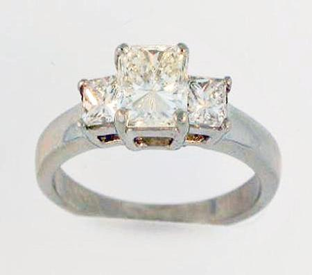 Platinum 1ct Diamond Engagement Ring with 2 Princess Cut diamonds on each side     01-00054